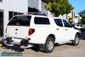 Rear right view of a Mitsubishi MN Triton in White On The Hoist @ Superior Engineering Deception Bay Showroom