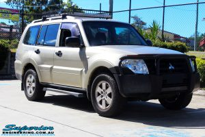 Right front side view of a Gold Mitsubishi NS Pajero Wagon before fitment of a Tough Dog 40mm Lift Kit