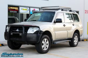 Left front side view of a Gold Mitsubishi NS Pajero Wagon after fitment of a Tough Dog 40mm Lift Kit