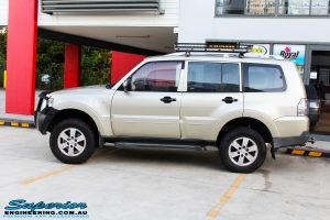 Side left view of a Gold Mitsubishi NS Pajero Wagon after fitment of a Tough Dog 40mm Lift Kit