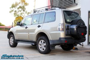 Rear left view of a Gold Mitsubishi NS Pajero Wagon after fitment of a Tough Dog 40mm Lift Kit