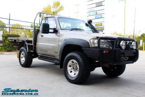 Right front side view of a Nissan GU Patrol Ute in Gold On The Hoist @ Superior Engineering Deception Bay Showroom