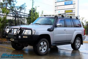 """Left front side view of a Silver Nissan GU Patrol Wagon before fitting a Dobinson 2"""" Inch Lift Kit + Coil Tower Brace Kit"""