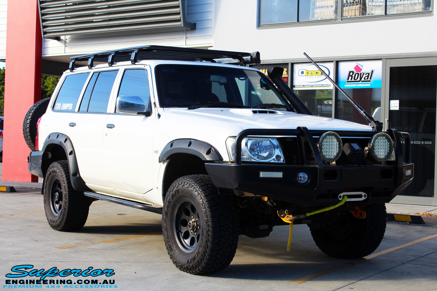 Right front side view of a White Nissan GU Patrol Wagon after fitment of Superior Hyperflex Radius Arms With Drop Boxes