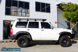 Right side view of a White Nissan GU Patrol Wagon after fitment of Superior Hyperflex Radius Arms With Drop Boxes