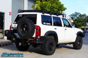 Rear right view of a White Nissan GU Patrol Wagon after fitment of Superior Hyperflex Radius Arms With Drop Boxes