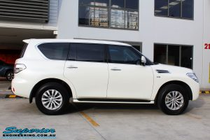 Right side view of a White Nissan Y62 Patrol Wagon before fitment of a Rhino 4x4 Evolution 3D Winch Bar + VRS Winch