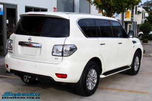 Rear right view of a White Nissan Y62 Patrol Wagon before fitment of a Rhino 4x4 Evolution 3D Winch Bar + VRS Winch