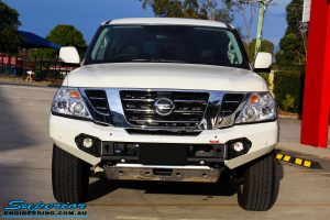 Front view of a White Nissan Y62 Patrol Wagon fitted with a Rhino 4x4 Evolution 3D Winch Bar + VRS Winch
