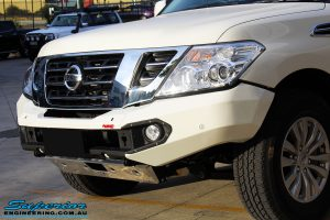 Close up front left side view of the Nissan Y62 and its fitted Rhino 4x4 Evolution 3D Winch Bar + VRS Winch