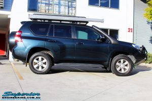 """Side right view of a Toyota 150 Landcruiser Prado in Blue before fitment of a 2"""" Inch Lift Kit"""