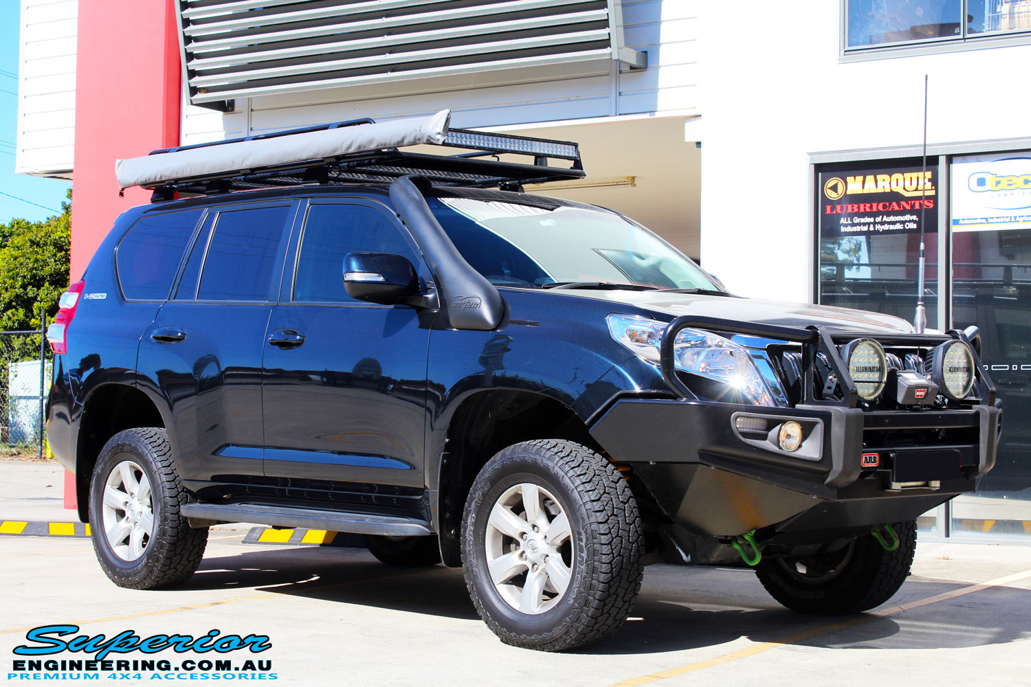 """Right front side view of a Toyota 150 Landcruiser Prado in Blue after fitment of a 2"""" Inch Lift Kit & Heavy Duty Towing Points"""