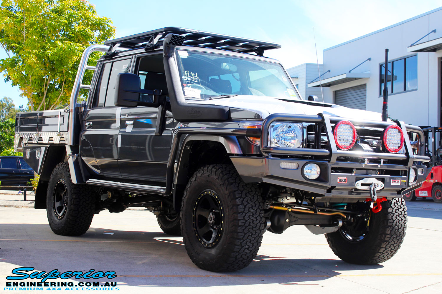 "Right front side view of a Grey Toyota 79 Series Landcruiser Dual Cab after fitment of a Superior 3"" Inch Nitro Gas Lift Kit, Airbag Man Digital Dual Air Control Kit w/Tyre Inflation & Leaf 3"" Inch Air Lift Kit"
