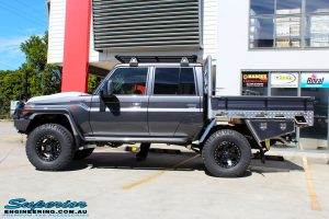 """Left side view of a Grey Toyota 79 Series Landcruiser Dual Cab after fitment of a Superior 3"""" Inch Nitro Gas Lift Kit, Airbag Man Digital Dual Air Control Kit w/Tyre Inflation & Leaf 3"""" Inch Air Lift Kit"""