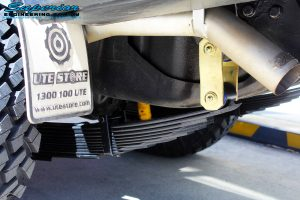 """Rear left close up underbody view of the fitted EFS 2"""" Inch Leaf Spring + Shackles"""