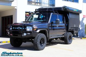 """Left front side view of a Grey Toyota 79 Series Landcruiser Dual Cab after fitment of a EFS 2"""" Inch Leaf Springs Rear Lift, Nitto Trail Grapplers & Procomp Series 69 Alloy Wheels"""