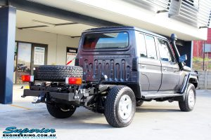 Rear right view of a Grey Toyota 79 Series Landcruiser after fitment of a MDT Tru Tracker Complete Rear Track Correction System