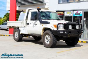 """Right front side view of a White Toyota 79 Series Landcruiser before fitment of a Superior Nitro Gas 2"""" Inch Lift Kit"""