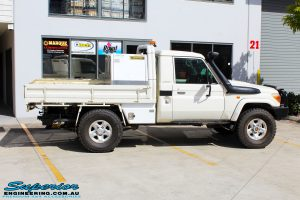 "Right side view of a White Toyota 79 Series Landcruiser before fitment of a Superior Nitro Gas 2"" Inch Lift Kit"