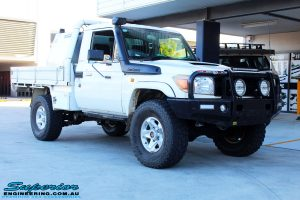 """Right front side view of a White Toyota 79 Series Landcruiser after fitment of a Superior Nitro Gas 2"""" Inch Lift Kit"""