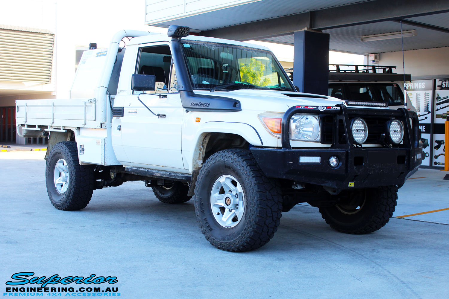 "Right front side view of a White Toyota 79 Series Landcruiser after fitment of a Superior Nitro Gas 2"" Inch Lift Kit"