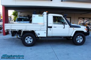"""Right side view of a White Toyota 79 Series Landcruiser after fitment of a Superior Nitro Gas 2"""" Inch Lift Kit"""