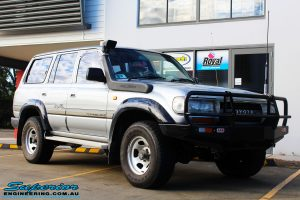 "Right front side view of a Toyota 80 Series Landcruiser in Silver before fitment of a Superior Nitro Gas Superflex 4"" Inch Lift Kit"