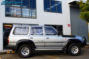 """Right side view of a Toyota 80 Series Landcruiser in Silver before fitment of a Superior Nitro Gas Superflex 4"""" Inch Lift Kit"""