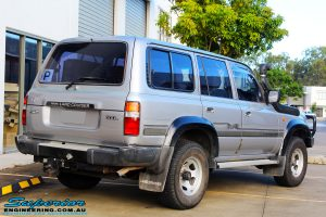 """Rear right view of a Toyota 80 Series Landcruiser in Silver before fitment of a Superior Nitro Gas Superflex 4"""" Inch Lift Kit"""