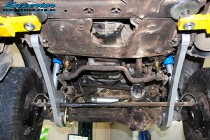 """Middle underbody view looking forward of the fitted Superior Superflex Radius Arms, 4"""" Inch Nitro Gas Shocks & Coil Springs"""