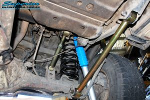 """Rear left underbody shot looking at the fitted Lower Heavy Duty Control Arm, Coil Spring, Superior 4"""" Inch Nitro Gas Shock & Upper Adjustable Control Arm"""