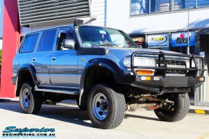 """Right front side view of a Toyota 80 Series Landcruiser in Silver after fitment of a Superior Nitro Gas Superflex 4"""" Inch Lift Kit"""