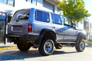 """Rear right view of a Toyota 80 Series Landcruiser in Silver after fitment of a Superior Nitro Gas Superflex 4"""" Inch Lift Kit"""