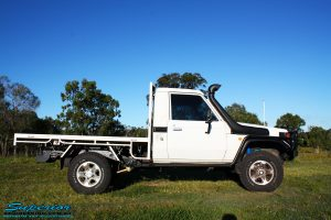 """Right underbody side view of a Toyota Landcruiser 79 Series after fitting a Superior Coil Conversion 2"""" Inch Stage 4 Full Front & Rear Kit + Airbag Man Coil Air Kit Helper, Superior Steering Damper, Tie Rod, Heavy Tow Points & Solid Drag Link Bar"""