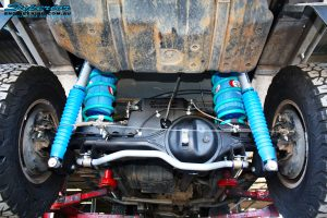 """Mid rear view of the fitted Superior Coil Conversion 2"""" Inch Rear Kit containing Remote Reservoir Shocks, Coil Springs, Swar Bar Kit, + Airbag Man Coil Air Kit Helper"""