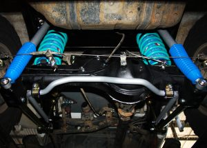 """Mid rear looking up of the fitted Superior Coil Conversion 2"""" Inch Rear Kit containing Remote Reservoir Shocks, Coil Springs, Swar Bar Kit, Lower Control Arms + Airbag Man Coil Air Kit Helper"""