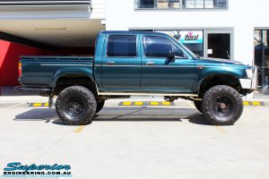 """Right side view of a Green Toyota SAF Hilux Dual Cab before fitment of a EFS 3"""" Inch Leaf Springs Rear Lift Kit"""