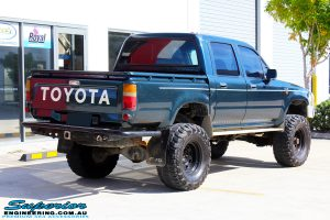 """Rear right view of a Green Toyota SAF Hilux Dual Cab before fitment of a EFS 3"""" Inch Leaf Springs Rear Lift Kit"""
