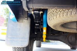 """Rear Left Underbody view of the fitted Bilstein 2"""" Inch Shock with Leaf Spring & U-Bolt Kit"""
