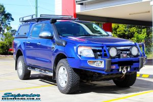 "Right front side view of a Ford PXII Ranger in Blue before fitment of a Superior Nitro Gas 2"" Inch Front Strut with King Springs"