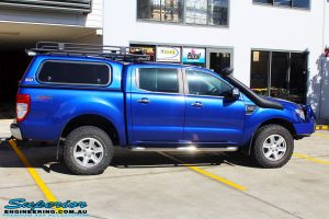 """Right side view of a Ford PXII Ranger in Blue before fitment of a Superior Nitro Gas 2"""" Inch Front Strut with King Springs"""