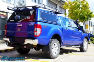 "Rear right view of a Ford PXII Ranger in Blue before fitment of a Superior Nitro Gas 2"" Inch Front Strut with King Springs"