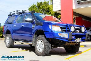 """Right front side view of a Ford PXII Ranger in Blue after fitment of a Superior Nitro Gas 2"""" Inch Front Strut with King Springs"""
