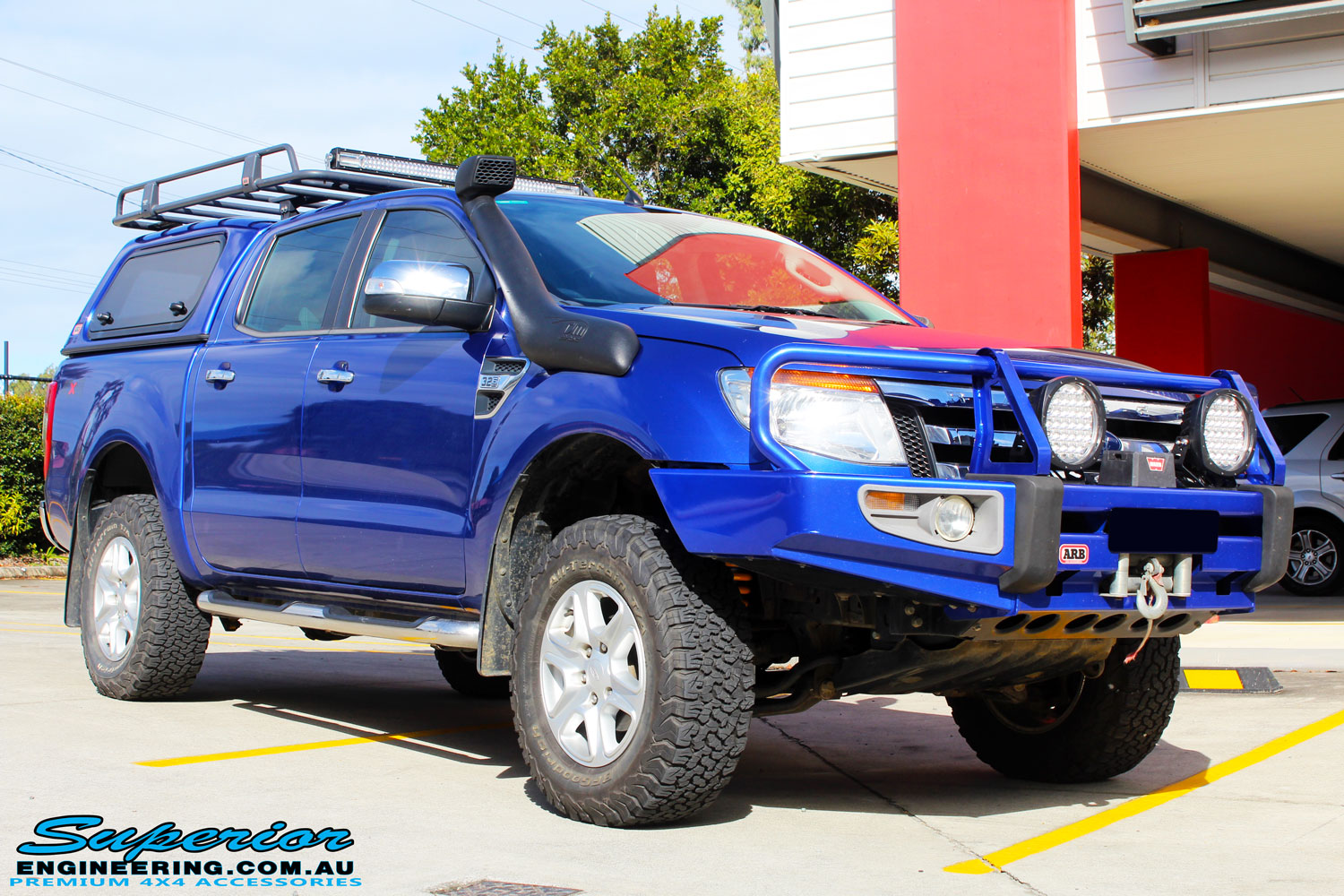 "Right front side view of a Ford PXII Ranger in Blue after fitment of a Superior Nitro Gas 2"" Inch Front Strut with King Springs"