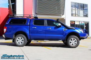 """Right side view of a Ford PXII Ranger in Blue after fitment of a Superior Nitro Gas 2"""" Inch Front Strut with King Springs"""