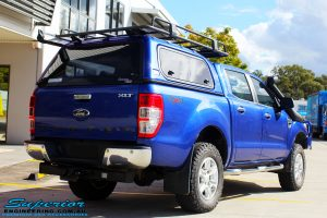 "Rear right view of a Ford PXII Ranger in Blue after fitment of a Superior Nitro Gas 2"" Inch Front Strut with King Springs"