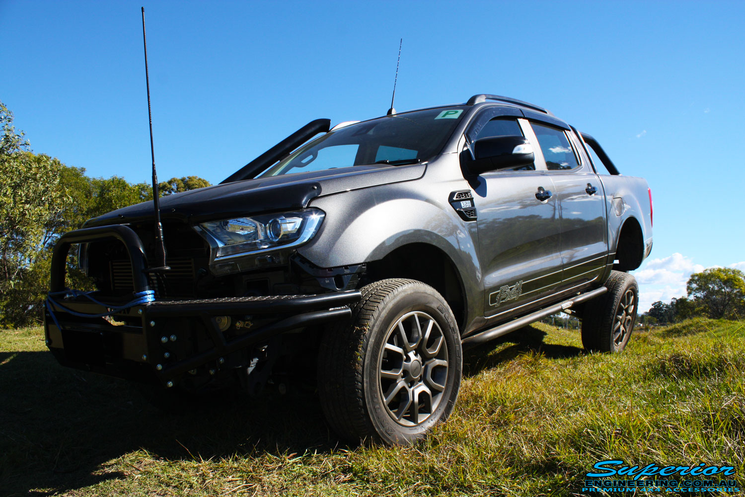 "Front left side view of a Silver Ford PXII Ranger Dual Cab after fitment of a Superior 2"" Inch Rear PXII Ranger Coil Conversion Kit, 2"" Inch Front Nitro Gas Struts, 2"" Inch King Front Coil Springs & Stainless Snorkel"