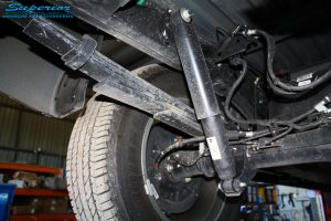 Close up shot of the left rear side of the previous leaf springs and shock before coil conversion