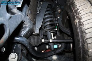 Front left inside view of the previous strut and coil spring before new ones are fitted