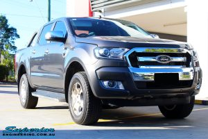 Right front side view of a Ford PXII Ranger in Grey before fitment of a Super Pro Ezy Lift 45mm Lift Kit